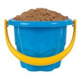 De emmer van het stuk speelgoed met zand stock foto