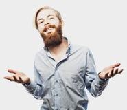 De emotionele zakenman trekt zijn handen apart, uitdrukkend verrassing en teleurstelling Bedrijfs concept stock foto