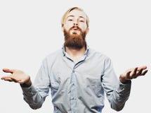 De emotionele zakenman trekt zijn handen apart, uitdrukkend verrassing en teleurstelling Bedrijfs concept stock afbeeldingen