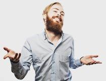 De emotionele zakenman trekt zijn handen apart, uitdrukkend verrassing en teleurstelling Bedrijfs concept stock fotografie