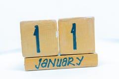 11 de enero Día 11 del mes, calendario en fondo de madera Invierno, concepto del año fotos de archivo libres de regalías