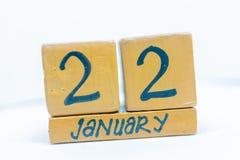 22 de enero Día 22 del mes, calendario en fondo de madera Invierno, concepto del año fotografía de archivo libre de regalías