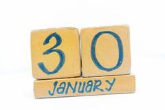 30 de enero Día 30 del mes, calendario en fondo de madera Invierno, concepto del año fotos de archivo libres de regalías