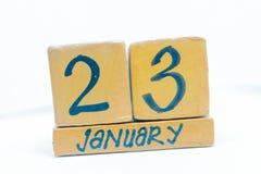 23 de enero Día 23 del mes, calendario en fondo de madera Invierno, concepto del año imágenes de archivo libres de regalías