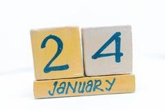 24 de enero Día 24 del mes, calendario en fondo de madera Invierno, concepto del año foto de archivo