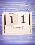 11 de enero Fecha del 11 de enero en calendario de madera del cubo Foto de archivo libre de regalías