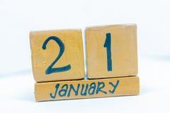 21 de enero mes del día 21of, calendario en fondo de madera Invierno, concepto del año foto de archivo