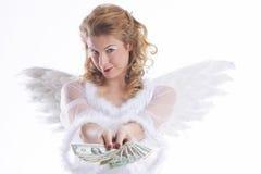 De engel van Chritsmas toont geld stock foto