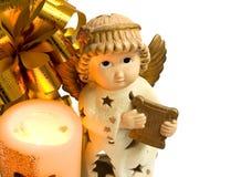 De engel van Kerstmis met gouden vleugels en harp, kaars 1 Stock Foto