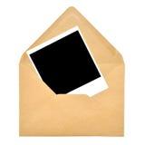 De envelop van het document en polaroidframe Stock Foto's