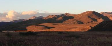 Hoog land bij Zonsondergang Stock Fotografie