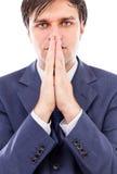 De ernstige zakenman die allebei houden dient voorzijde van zijn mond in stock foto's