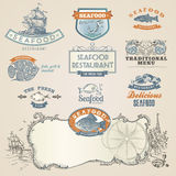 De etiketten en de elementen van zeevruchten Stock Afbeelding