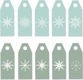 De etiketteninzameling Blauwe en groene etiketten met witte sneeuwvlokken Stock Foto