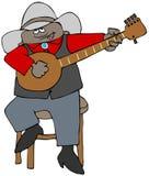 De etnische zitting van de banjoplukker op een kruk Stock Foto