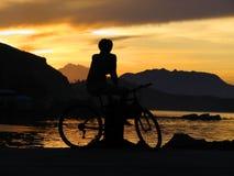 De exotische zonsondergang van de jongen @ stock foto's