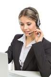 De exploitant van de telefoon met hoofdtelefoons en laptop stock fotografie