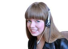 De exploitant van het meisje met hoofdtelefoon over wit. Royalty-vrije Stock Foto