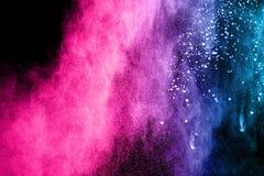 De explosie van het kleurenpoeder op donkere achtergrond Royalty-vrije Stock Foto's