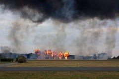 De explosies bij een militaire waaier Stock Afbeelding