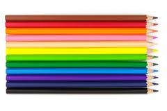 De färgrika färgblyertspennorna Royaltyfria Bilder