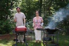 De Familie van de barbecue stock afbeeldingen