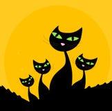 De familie van de kat - zwart silhouet op oranje achtergrond Royalty-vrije Stock Fotografie