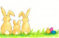 De familie van de paashaas met geschilderde eieren stock illustratie