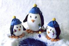 De familie van de pinguïn visserij Royalty-vrije Stock Afbeeldingen
