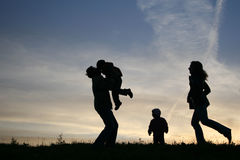 De familie van het silhouet van vier Stock Fotografie
