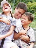 De familie van het tennis. stock foto's