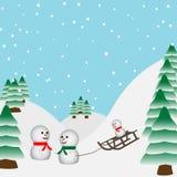 De familie van sneeuwmannen het spelen in Royalty-vrije Stock Afbeeldingen