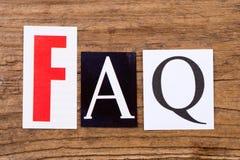 ` de FAQ de ` d'expression sur le fond en bois Photographie stock libre de droits