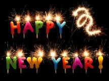 De feestelijke Gelukkige fonkelende kaarsen van het Nieuwjaar Stock Afbeeldingen