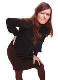 De ferimento fêmea traseiro da mulher da dor do osteochondrosis da menina mais baixos jovens b Fotografia de Stock