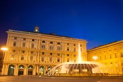 De Ferrari square, Genova, Italy. At dusk with the famous fountain Royalty Free Stock Photos
