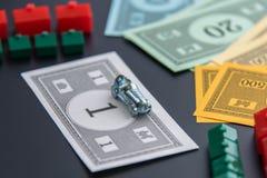 8 de fevereiro de 2015: Houston, TX, EUA Carro do monopólio, dinheiro, hotéis Fotografia de Stock