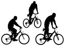 De fiets van silhouetten Stock Foto's