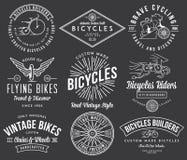 De fietsbouwers plaatsen wit 2 op zwarte Stock Foto