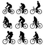 De fietsen van het silhouet Royalty-vrije Stock Afbeeldingen