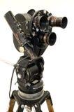 De filmcamera en de driepoot. Stock Foto's