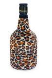 De fles is behandeld met een luipaardkleuring royalty-vrije stock afbeeldingen