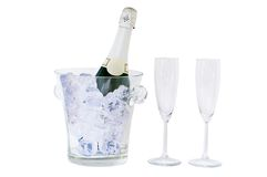 De fles en het glas van Champagne dat op wit wordt geïsoleerds Royalty-vrije Stock Foto