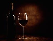 De fles en het glas van de Rewwijn Stock Foto