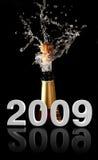 De fles van Champagne met het shotting van cork Stock Fotografie