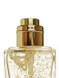 De fles van de luxe met goltserum Royalty-vrije Stock Afbeeldingen