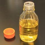 De fles van de steekproef Stock Foto's