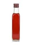 De fles van het glas met rode wijnazijn Royalty-vrije Stock Afbeelding