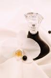 De fles van het parfum Stock Foto's