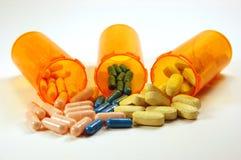De flessen en de pillen van de geneeskunde Stock Foto's